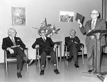 Presentation of the Two Millionth book by Walter Stone.  Seated are from left Sir Herman Black, Sir Bruce Williams and the librarian Harrison Bryan
